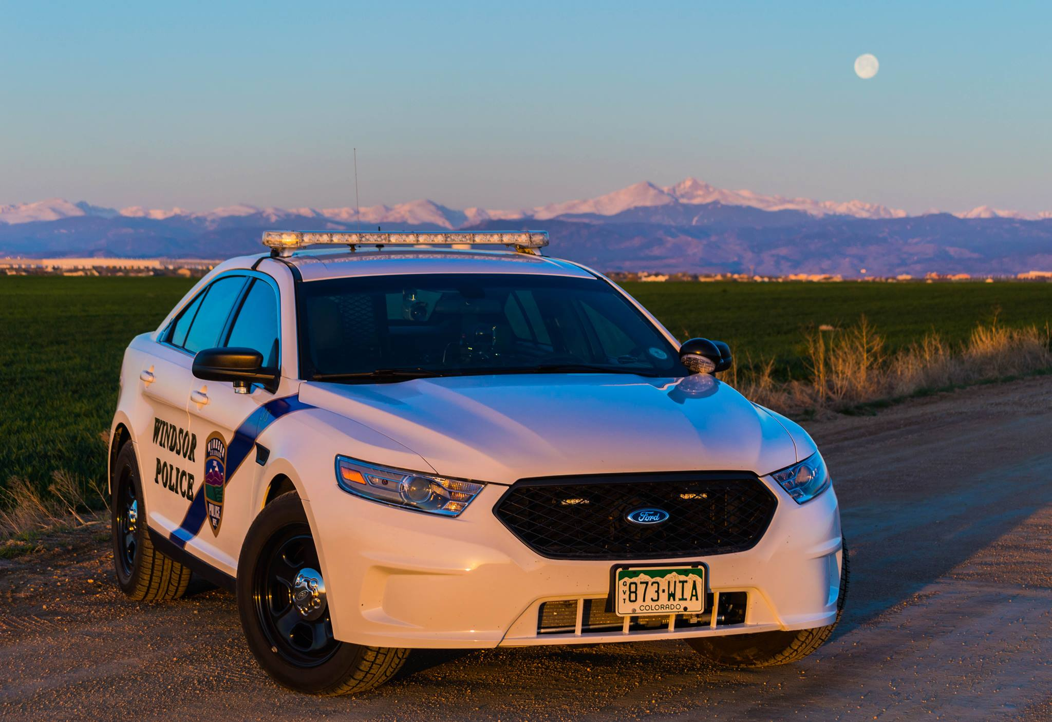Patrol car with mtns.jpg