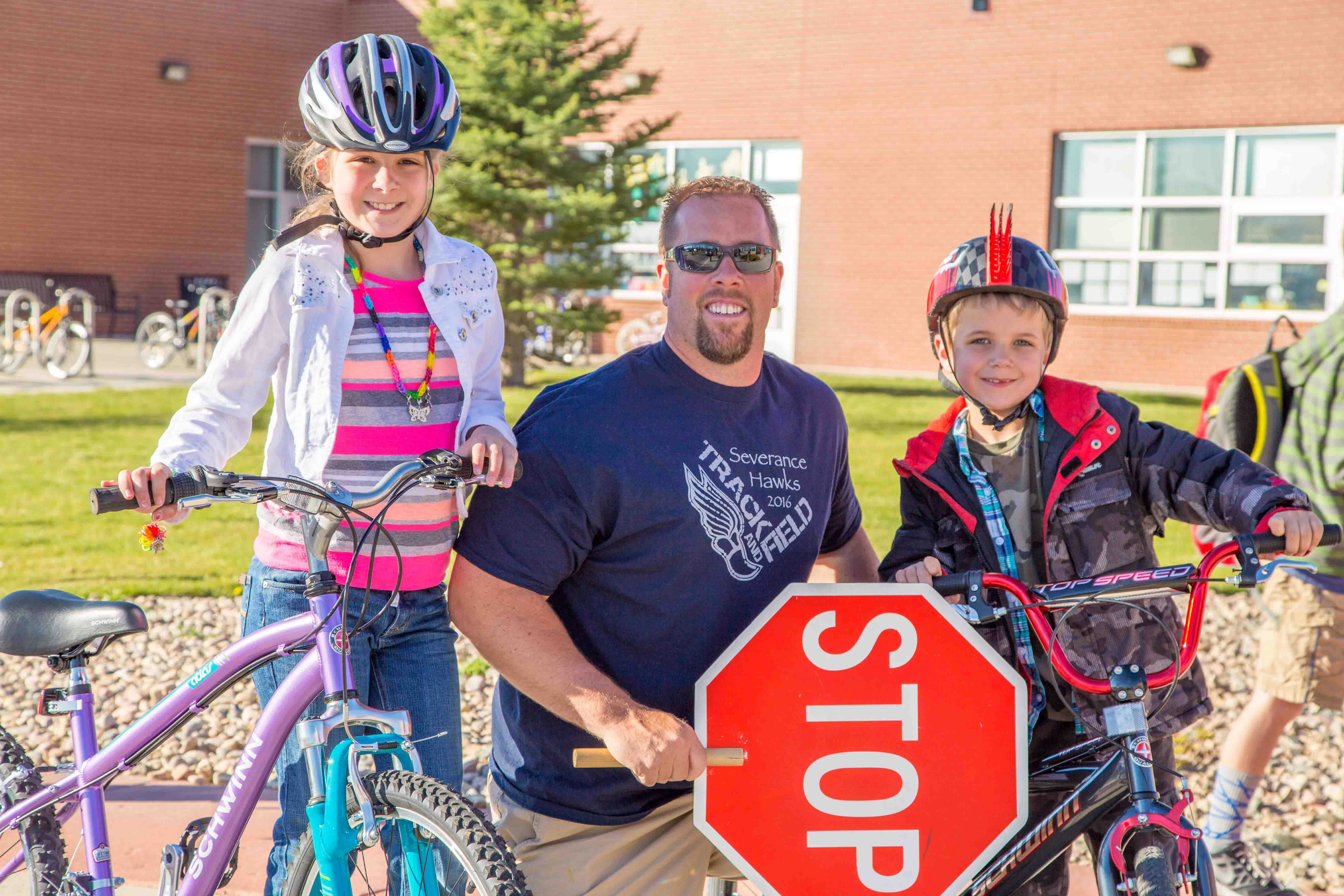Kids on Bikes with Crossing Guard
