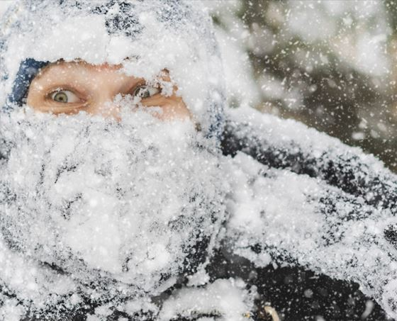 Man is pictured covered in snow